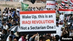 Sunni Muslims take part in a demonstration against Prime Minister Nuri al-Maliki in Fallujah on April 5.