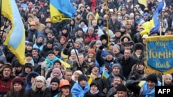 Opposition protesters shout slogans during a rally on Independence Square in Kyiv on December 13.