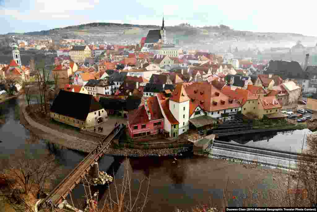 """Foggy Small Town"" by Duowen Chen. Český Krumlov, South Bohemia, Czech Republic. ""This photo was captured at noon, 25.12.2013, from the castle which is located on the edge of the small town and is the perfect viewpoint for the panorama of the almost intact historical town. The fog and mist suffused and gave the town a sense of mystery."""