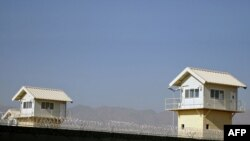This file photo taken on November 15, 2009, shows watchtowers along the perimeter of the Bagram prison, north of Kabul, in November 2009.