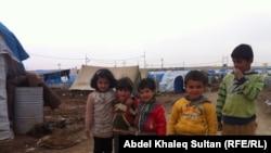 أطفال في مخيم دوميز للاجئين السوريين الكرد في دهوك بإقليم كردستان العراق