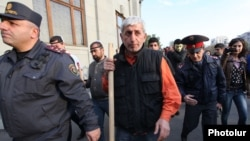 Opposition activist Shant Harutiunian leads an antigovernment demonstration from Yerevan's Liberty Square on November 5.