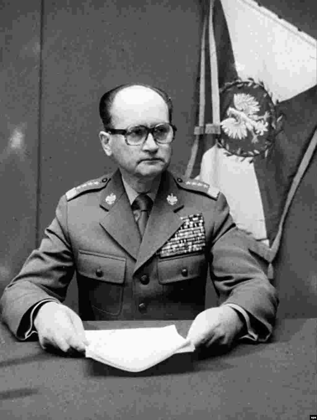 A file photo made available on 25 May shows Jaruzelski announcing martial law in Poland on December 13, 1981. He cited purported evidence of the planning of a coup, including involving Solidarity leaders.