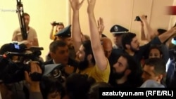 The demonstrators stormed Yerevan's City Hall on May 16