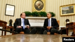 Pakistani Prime Minister Nawaz Sharif (left) says he told U.S. President Barack Obama to halt drone attacks in Pakistan.