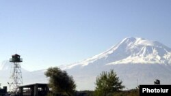Armenia -- A border-guard watchtower on the Armenian-Turkish frontier pictured against the backdrop of Mount Ararat.