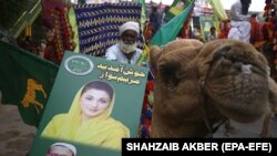 Supporters of opposition political party Pakistani Muslim League (Nawaz) hold a picture of leader Maryam Nawaz Sharif during an anti-government rally in Karachi on October 18.