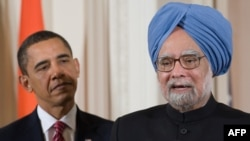 U.S. President Barack Obama and Indian Prime Minister Manmohan Singh speak to the press in Washington.