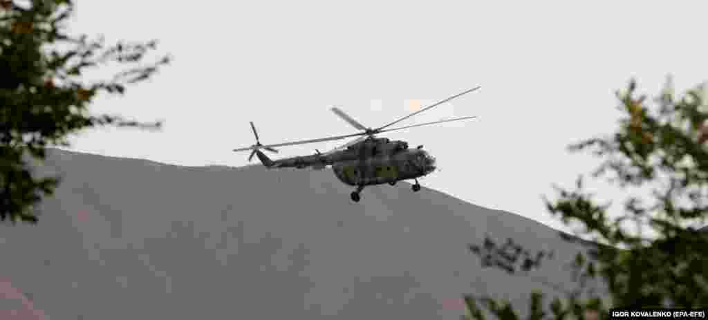 A helicopter above the compound.
