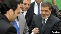 Egyptian President Muhammad Morsi voting in the constitutional referendum in Cairo on December 15.