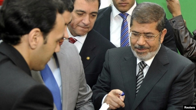 Egyptian President Muhammad Morsi voting in the constitutional referendum in Cairo on December 15.