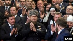 Ramzan Kadyrov (center) applauds after his inauguration ceremony for a third term in Grozny on October 5.