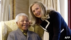 Then-U.S. Secretary of State Hillary Clinton at a meeting with Nelson Mandela at his home in Qunu in August 2012.