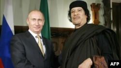 Libyan leader Muammar Qaddafi (right) with Russian Prime Minister Vladimir Putin in Moscow