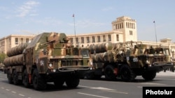 Armenia - Russian-made S-300 air-defense systems of the Armenian army are driven through Yerevan's Republic Square during a military parade rehearsal, 19Sep2011.