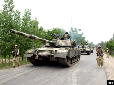 Pakistani Army soldiers advance into the restive Buner region on May 3.