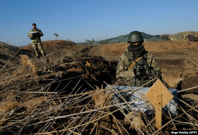 Ukrainian servicemen attend military drills near the village of Urzuf, not far from the city of Mariupol in eastern Ukraine, on November 29. The Ukrainian military is on full combat alert.