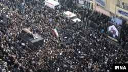 Iranians gather around a hearse carrying the coffin of former president Akbar Hashemi Rafsanjani during his funeral ceremony in the capital Tehran, 10 Jan 2017