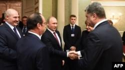 Участники переговоров по урегулированию конфликта в Украине. Минск, 11 февраля 2015 года.