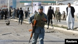 An Afghan policeman arrives at the site of a suicide attack in Kabul on April 10.
