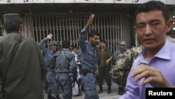 Policemen were dispatched to try and keep order at a branch of Kabul Bank in the midst of September's run on the bank.