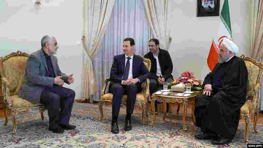 С началом конфликта в Сирии в 2011 году, «Аль-Кудс» оказывали всяческую поддержку сирийскому президенту Башару Асаду. На фотографии Асад встречается в Тегеране с иранским президентом Хасаном Роухани и Касемом Сулеймани 25 февраля 2019 года