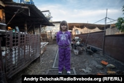 Sabrina, 7, on her family's farm in Pavlopil