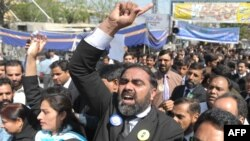 Pakistani lawyers march during a protest in Rawalpindi on March 13.