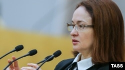 Russian Central Bank Governor Elvira Nabiullina says the bank won't try to help the Kremlin close a budget gap by devaluing the ruble.