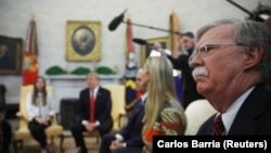 U.S. National Security Advisor John Bolton (R) listens as President Donald Trump, Vice President Mike Pence and White House senior advisor Ivanka Trump meet with Fabiana Rosales, wife of Venezuelan opposition leader Juan Guaido, in the Oval Office> March 27, 2019