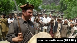 A drummer celebrates spring in a Kalash village.