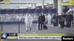 Эксперты ВОЗ прибывают в Ухань