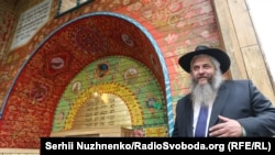 The newly inaugurated wooden synagogue is decorated with patterns and texts of prayers that recreate the traditional interiors of ancient synagogues in western Ukraine.