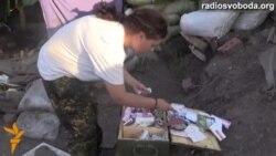 Жінка-доброволець в зоні АТО