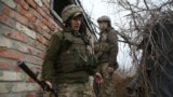 Ukrainian servicemen hold a position on the front line with Russia-backed separatists near the small city of Marinka in the Donetsk region on April 12. Nearly 30 Ukrainian soldiers have been reported killed since the start of the year.