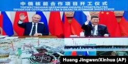 Владимир Путин и Си Цзиньпин участвуют в совместной церемонии по видеосвязи 19 мая 2021 года