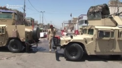 Blasts Kill More Than 20 In Iraq