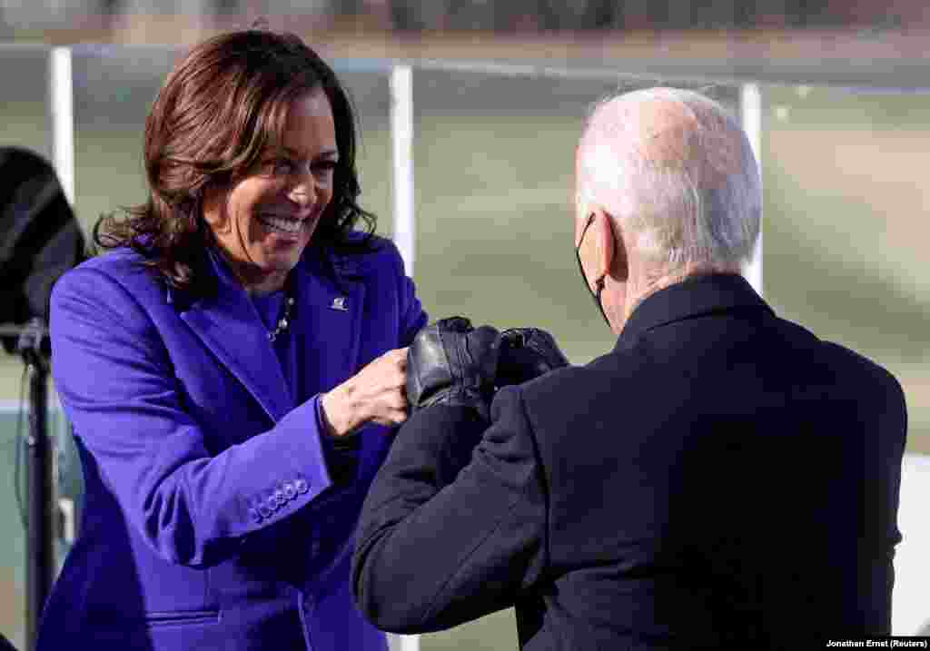 Kamala Harris bumps fists with Joe Biden after being sworn in as Vice President of the United States during the inauguration on the West Front of the U.S. Capitol in Washington, U.S., January 20, 2021. REUTERS/Jonathan Ernst/Pool
