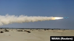 A missile is launched by Iran's military during a naval exercise in the Gulf of Oman on January 14.