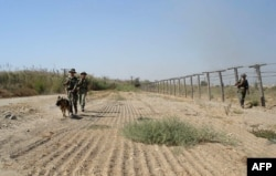Tajik border guards patrol the Afghan border somewhere outside Panj.
