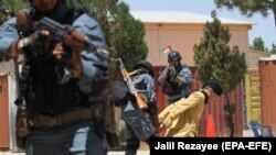 FILE: Afghan police officers show their counterterrorism skills during a training session in Gozara district of Herat on July 21.