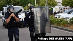 Police deployed in the Gresilles area of Dijon on June 15.