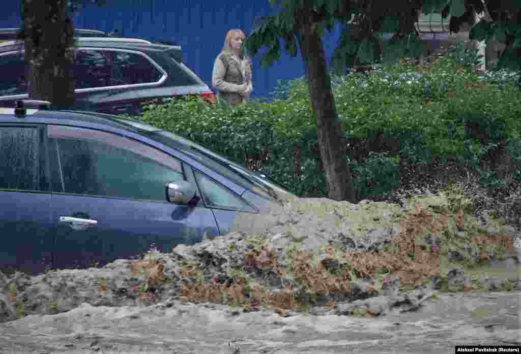 A car is inundated following heavy rainfall in Yalta, Crimea, on June 18.