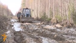 A Muddy Tractor Ride Through Siberia