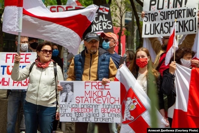 Alyaksey (center) and Maryya Dalbenka (to his right) at a Belarus solidarity rally in Canada.