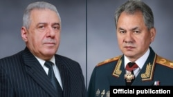 Defense Ministers Vagharshak Harutiunian (L) of Armenia and Sergei Shoigu of Russia.