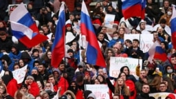People attend a concert marking the seventh anniversary of Russia's annexation of Crimea at Luzhniki Stadium in Moscow on March 18.