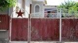 Moldova -- La Cantemir (red star, soviet symbol, on the old gate)