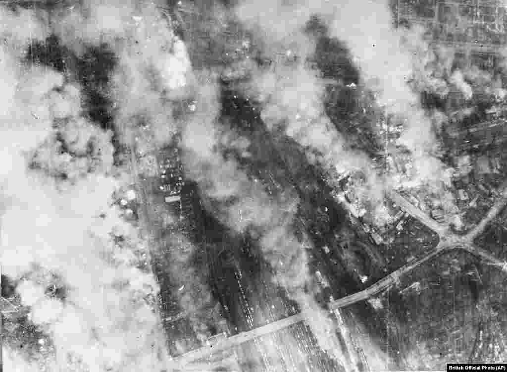 The smoldering outskirts of Dresden during the attack. Three hours after the first air raid, as Dresden's firefighters were battling the blazes and surviving civilians were clambering out of their shelters, a second wave of British bombers dumped another 1,800 tons of bombs from the night sky onto the flaming city.