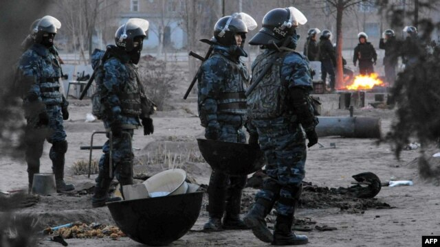 Riot police patrol Zhanaozen on December 18, two days after the worst of the bloodshed.